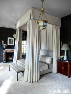 Black Walls Custom black paint by Fine Paints of Europe sets off a magnificent bed in the master bedroom of a Chicago townhouse decorated by Steven Gambrel. The voluminous canopy and hangings are in Corelli cotton from Fabricut with Scalamandré tape trim, and the bed frame is upholstered in Lockett from Stark. Pendant lanterns, Circa Lighting.