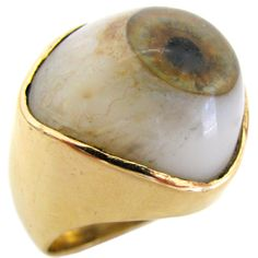 """An Amusing Gold and Glass Ring, An eccentric Glass Eye ring, the 14k yellow gold band with 1"""" grey, green, brown and bloodshot glass eye. Not for the faint of heart. Freaky Good."""