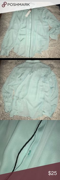 ELLE Long-sleeved blouse I love this sky- blue color but it just washes me out.  this blouse is super gorgeous I love the embroidered detailing down the button line and around the collar.  100% polyester. Hand wash or dryclean IF you want to keep it looking beautiful. ELLE Tops Blouses
