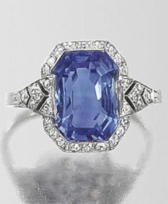 AN ART DECO SAPPHIRE AND DIAMOND RING, CIRCA 1920. Centring a canted rectangular sapphire weighing 6.90 carats, mounted in platinum and set with diamonds. #ArtDeco #ring