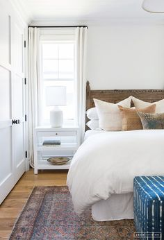 Warm up white walls with wood tones and fabrics.