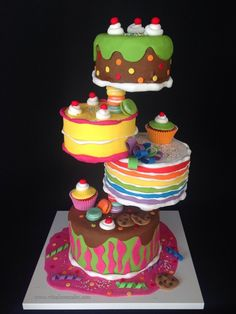 Gravity defying Candyland cake! All decorations are made of sugarpaste...