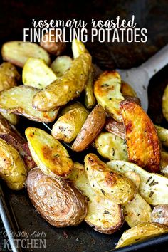Rosemary Roasted Fingerling Potatoes, a beautiful, flavorful side dish for Thanksgiving, or any night of the week! from ThisSillyGirlsLife.com #thanksgiving #thanksgivingrecipes #roastedpotatoes