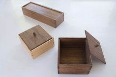 Small wooden boxes made in maple and walnut.