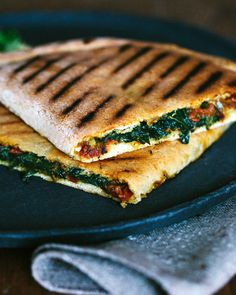 Flatbread out of the grain from the Inca, filled with spinach and tomatoes.