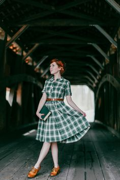 Green plaid dress, camel Oxford heels.