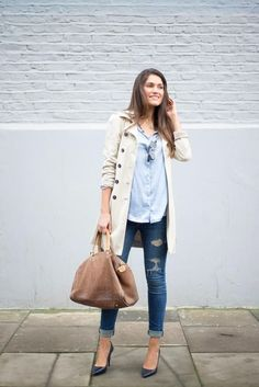 Shop this look for $160:  http://lookastic.com/women/looks/dress-shirt-and-skinny-jeans-and-trenchcoat-and-heels-and-tote-bag/2355  — Light Blue Dress Shirt  — Blue Ripped Skinny Jeans  — Beige Trenchcoat  — Black Leather Pumps  — Brown Leather Tote Bag