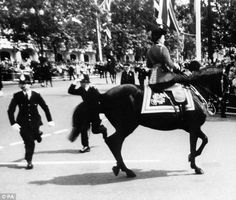 of Queen Elizabeth II calming her horse Burmese while policeman spring to action after shots were heard as she rode down the Mall during the Trooping the Colour Parade. Queen's Official Birthday, Trooping The Colour, Horse Guards Parade, Prince Charles, Prince Philip, Prince Harry, Sports Pictures, Queen Elizabeth Ii, A 17