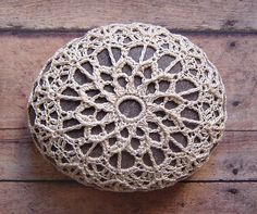 I love these. There is just something about them...  Folk Art Original Handmade Crochet Lace Stone Table by Monicaj, $49.00