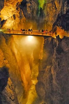 These are the impressive Škocjan Caves in Slovenia , where the Reka River disappears deep underground. People have lived in the caves since prehistoric times, and the internal atmosphere even has its own eco-system.