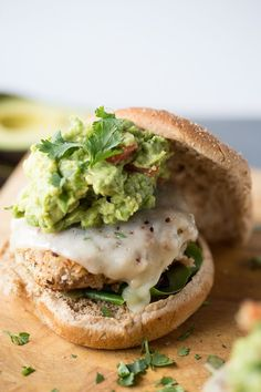 Turkey burger recipe with lots of taco flavoring and topped with homemade guacamole! lemonsforlulu.com