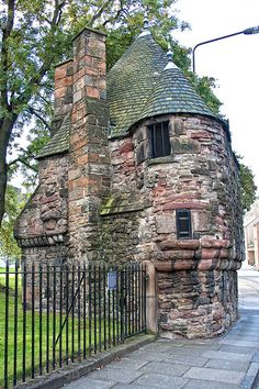 "Queen Mary's Bath House. From sign ""This little two-storeyed building is traditionally associated with Mary Queen of Scots (1542-1567), It was once attached to a boundary wall enclosing the King's privy garden and served as a pavilion or summer house where the royal family might relax whilst strolling in the garden. Whether it ever contained a bath is unknown"". It stands in the grounds of Holyrood Palace. Edinburgh, Scotland."