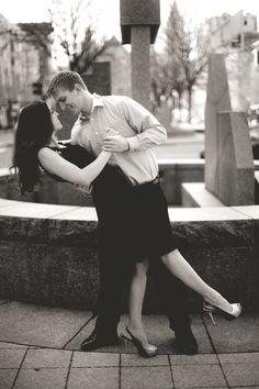 city couple/engagement pose