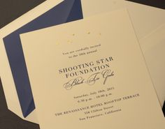 Be they the celestial or the red carpet variety, stars bring the most exquisite twinkle to any evening. Engraved in gold floating atop regent blue ink, they make this the perfect invitation for a gala most grand.