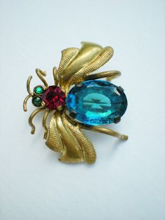 Queen Bee - antique Czech brooch in emerald, red, and blue
