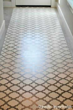 Stenciled concrete floor - great way to update a floor for relatively little time and money!