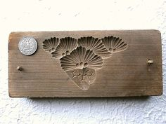 "This is a vintage mold called ""kashigata"".    Often made of sakura (cherry wood) and seasoned for about 3 years before carving, kashigata were used to make dried confectionery made of rice flour and sugar called rakugan. Earliest records show that this practice dates back to the mid-17th century. Japan"