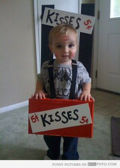 kissing booth halloween costume...no directions...appears to use suspenders to hold it up (make your own suspenders with clips and black elastic from a fabric store)...the rest appears to be made with a box painted red & black and poster board kisses signs...love the creativity of home made costumes