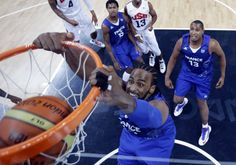 Olympics: Day Two - JULY 29: France's Ronny Turiaf scores as teammates Boris Diaw and Mickael Gelabale look on during the first half of a preliminary men's basketball game against the USA on Day 2 of the London 2012 Olympic Games at the Basketball Arena on July 29, 2012 in London, England. (Photo by Eric Gay - IOPP Pool /Getty Images)