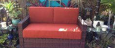 Custom red sofa cushions on an outdoor patio.