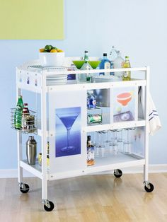 Store all your liquor and drink-making ingredients on a rolling cart to bartend anytime, anywhere. Compartments and hanging racks for glasses make things easily accessible and within reach