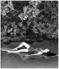 Model in swimsuit by Rose Marie Reid, photo by Norman Parkinson, Frenchman's Cove, Jamaica, 1960