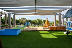 Overview over the tranquil play yard baby and toddler section. Baby Play Yard, Astroturf, Herb Farm, Backyard Designs, Kids Playing, Playground, Pergola, Herbs, Outdoor Structures