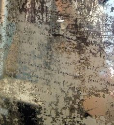 DIY: Decoupaged Mirror - this is such an awesome project!!! This blogger simply decoupaged script onto the reverse side of an aged mirror! by Shannon Cooper Alred