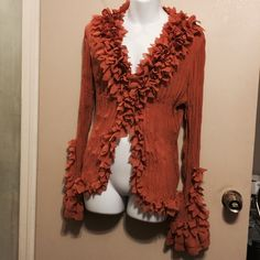 Kaelyn Max bRuffed cardigan with tons of ruffles This is a 100% polyester cardigan . Has ruffles around front and sides. End of sleeves has a open and a ruffles . Has a button closer. Kaely n. Max Other