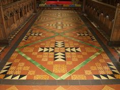 St Mary's Church, Thirsk: The tiled floor of the chancel. Many of the tiles are made in the style of medieval tiles found in monastic establishment eg Byland Abbey and Rievaulx Abbey