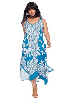 Sweeping scarf print maxi dress with V-neckline and adjustable shoulder straps. A dramatic hankie hem defines this plus size dress.  Classic A-line silhouette is flattering, comfortable and minimizes hips and thighs V-neckline elongates your neck and keeps you cool Sleeveless style keeps you cool Easy pull-on for ease in dressing Hankie hemline creates movement and drama Easy-care rayon You'll love styling this with one of our cropped denim jackets, floppy straw hats or statement necklaces…