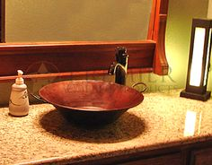 This handcrafted, Round Miners Pan Vessel Hammered Copper Sink, gives a look of rustic luxury that can tie together an entire room.   (Model Number of sink shown: VR16MPDB)