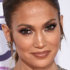 http://www.vivala.com/makeup/jennifer-lopez-best-makeup/6797/She kills in a brown lip because, of course./13