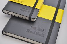 Red Bull custom logo embossing on black moleskine, large and pocket size, by Jenni Bick Bookbinding www.jennibick.com