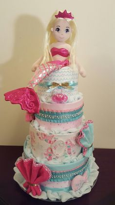Mermaid diaper cake! It's a girl! Mermaid baby shower centerpiece gift.  Created by Kim Swinson-Simply Showers.  Visit my Facebook page for more pics and orders.