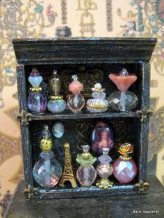 Marie Antoinette Perfume Cupboard OOAK dollhouse miniature in one inch. I love that beads were used to make these lovely little bottles!