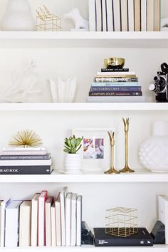 White and brass has been a gorgeous trend lately. Pair simple white ceramics with brass antiques for a chic aesthetic.