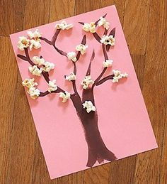 Celebrate spring with this easy #popcorn cherry blossom tree craft from @apttherapy.