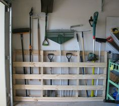 s 19 little known ways to use your wasted wall space, organizing, storage ideas, wall decor, Attach pallets to the garage wall for tools
