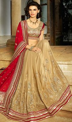 Be an exclusive princess of luxury dressed in this beige and red color embroidered georgette net half n half sari. You could see some interesting patterns carried out with bead, stones, lace and resham work.  #beigecolorsarees #embroideredsaris #womenwears