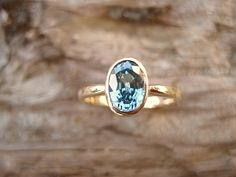 Oval Blue Zircon Ring in 14 Karat Yellow Gold. $440.00, via Etsy.