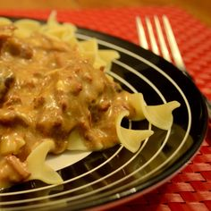 Crock pot Beef Strogenoff Recipe 2 pounds cubed stew meat 2 cans Condensed Golden Mushroom Soup 1 large onion diced 3 T of Worcestershire sauce 1/2 cup water 8 oz of cream cheese 1 t Garlic Salt 1/8 t Paprika 1/8 t ground red pepper Egg Noodles