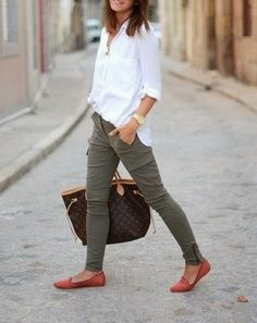 Green Skinies Pent With White Blouse And Deep Carmine Pink Flat Shoes
