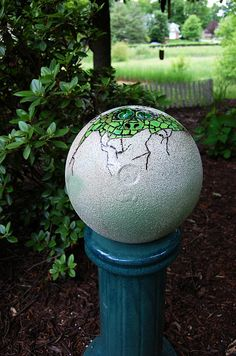 Bowling ball garden art. Dragon's Egg. Made using stone texture spray.