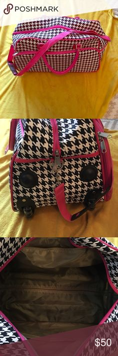 Houndstooth Weekender Bag with handle and wheels Like new! Used only once.  It has a shoulder strap and also the ability to be rolled like a suitcase. Bags Travel Bags