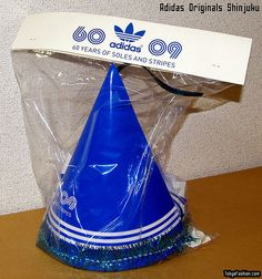 A party hat and party goods package given away free for the opening of the new Shinjuku Adidas Originals shop.     shoes