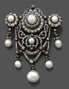 A magnificent antique gold, silver, diamond and pearl brooch, circa 1890. Set with fine bouton and half pearls, and numerous brilliant-cut diamonds, mounted in rose gold and silver. 5.2 x 6.8cm. #antique #brooch