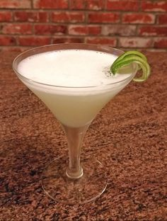 ELEGANT LADY - Gin (2 oz), Cointreau (1 oz), Lime Juice (1 oz), Egg White (1), Orgeat (1 dash). Shake dry (no ice) to incorporate the egg white, then add ice and shake again. Strain into a chilled cocktail glass and garnish with lime peel. This is light and refreshing and quietly complicated. I'm sure the gin will change the nature of the drink considerably; I used Hendricks and it was the right balance of lovely.