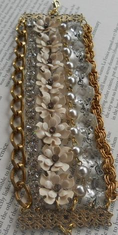 I have a thing for multi-strand bracelets, and this one has it all: mixed metals, floral motif, sparkly crystals and rhinestones. I would wear this with jeans and a white tank in the summer.
