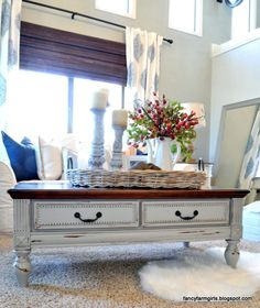 Turn your old coffee table into a beautiful farm house style table in an hour with a little paint and stain. Fancy Farm Girls for All Things Thrifty